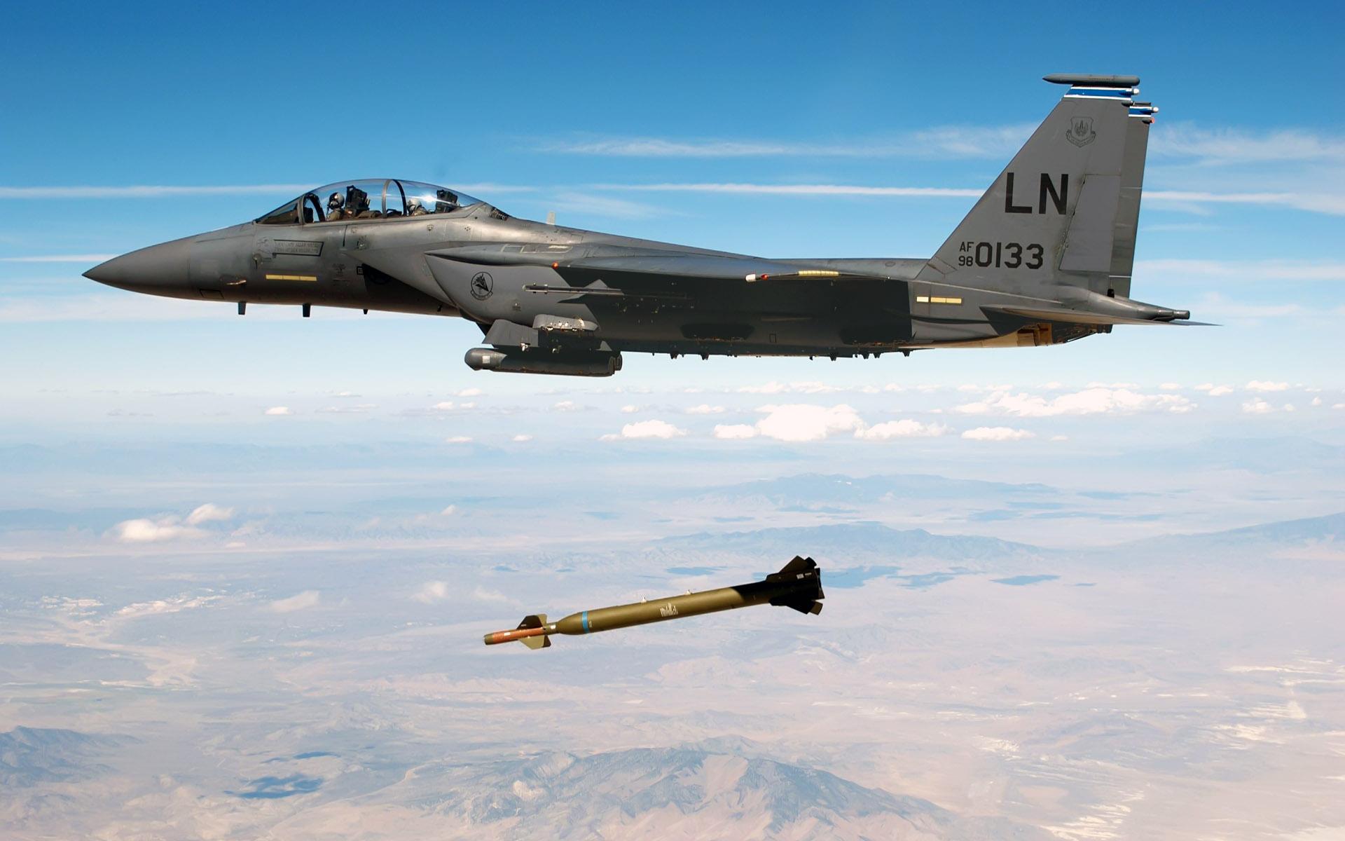 jet fighter drops missile wide