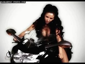 sensual brunette on a motorbike